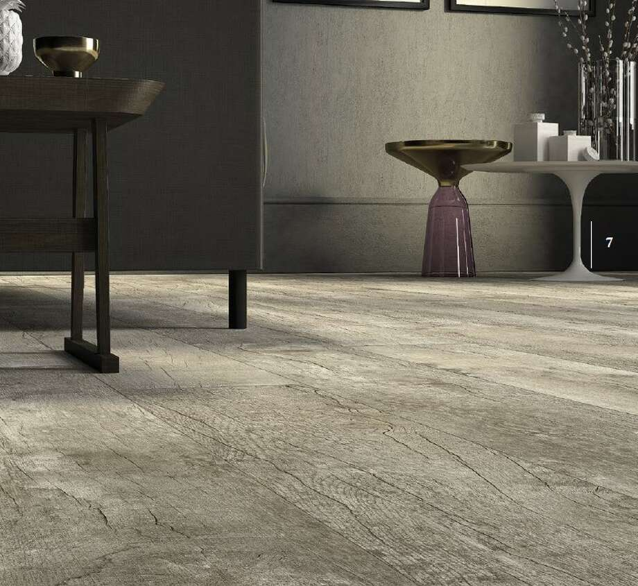 Porcelain tile resists water, and many styles are able to replicate the texture of wood.  Photo: Thorntree Slate & Marble