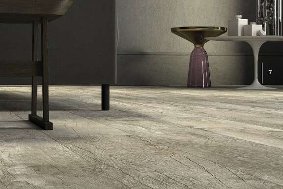 Porcelain tile resists water, and many styles are able to replicate the texture of wood.