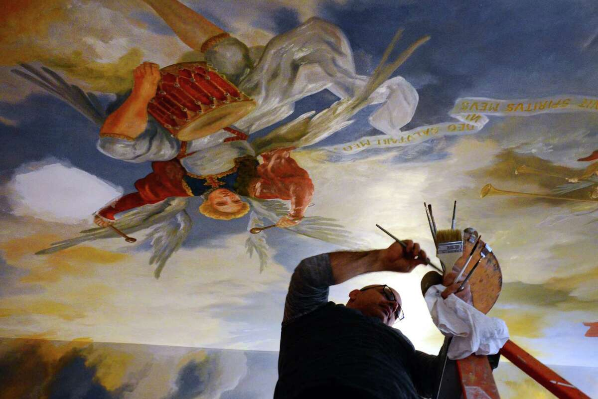 Painter Paul Armesto, of Queens, paints a mural depicting the Assumption and Coronation on the ceiling in the chapel inside the rectory at Assumption Church in Ansonia, Conn. on Tuesday Oct. 3, 2017. The remodeling of the chapel should be completed before Christmas and will be used for daily Mass, small funerals and small weddings.