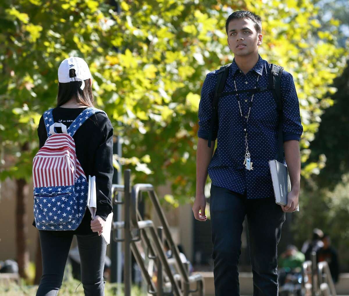 Neeraj Dharmadhikari, a computer science major, walks to his next class at De Anza College in Cupertino, Calif. on Tuesday, Oct. 3, 2017.