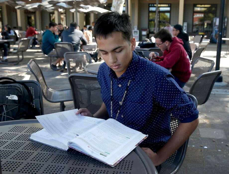 Neeraj Dharmadhikari, who has an H-4 visa, studies for a physics class at De Anza College. Photo: Paul Chinn, The Chronicle
