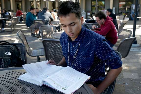 Computer science student Neeraj Dharmadhikari prepares for an advanced physics class at De Anza College in Cupertino, Calif. on Tuesday, Oct. 3, 2017.