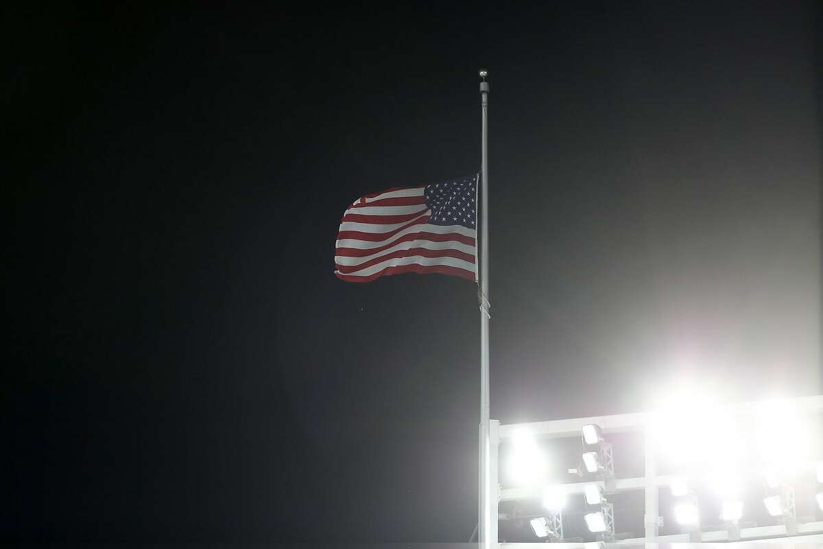 NEW YORK, NY - OCTOBER 03: The flag is flown at half-staff in wake of deadly Las Vegas shooting during the American League Wild Card Game between the Minnesota Twins and the New York Yankees at Yankee Stadium on October 3, 2017 in the Bronx borough of New York City. (Photo by Elsa/Getty Images)