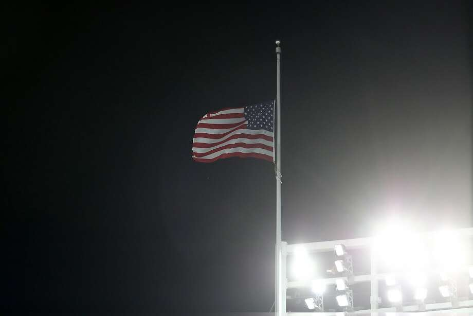 The flag is flown at half-staff at Yankee Stadium in New York in the aftermath of the Las Vegas massacre. Photo: Elsa, Getty Images