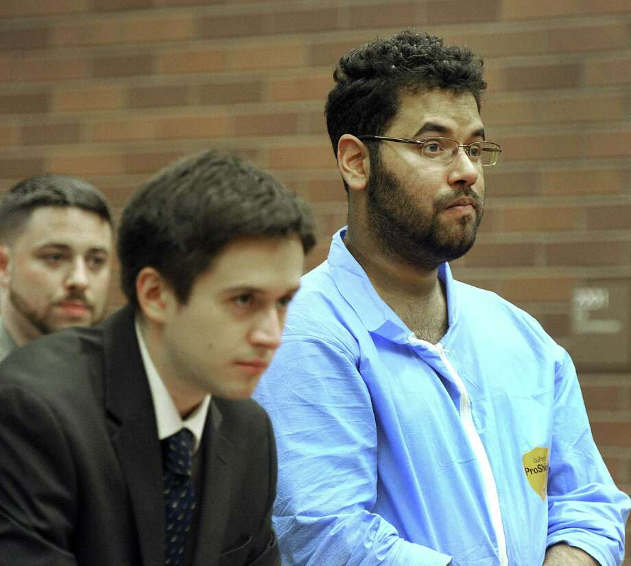 Dennis Salzebrunn, left, an intern with the public defender's office, represents Steven Flood, 32, in his court appearance Friday, May 5, 2017. Photo: Carol Kaliff / Hearst Connecticut Media / The News-Times