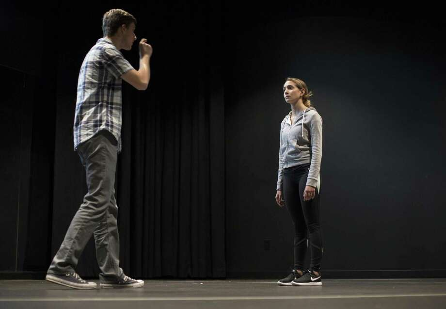 "Quinnipiac University students Nick Fetherston of Ashland, Massachusetts and Nicolette Fino of Marlboro, New Jersey, rehearse their roles as Father Flynn and Sister Aloysius respectively in the upcoming production of ""Doubt,"" the first to be performed in the new Theatre Arts Center. Photo: Autumn Driscoll / Quinnipiac University / (Autumn Driscoll / Quinnipiac University)"