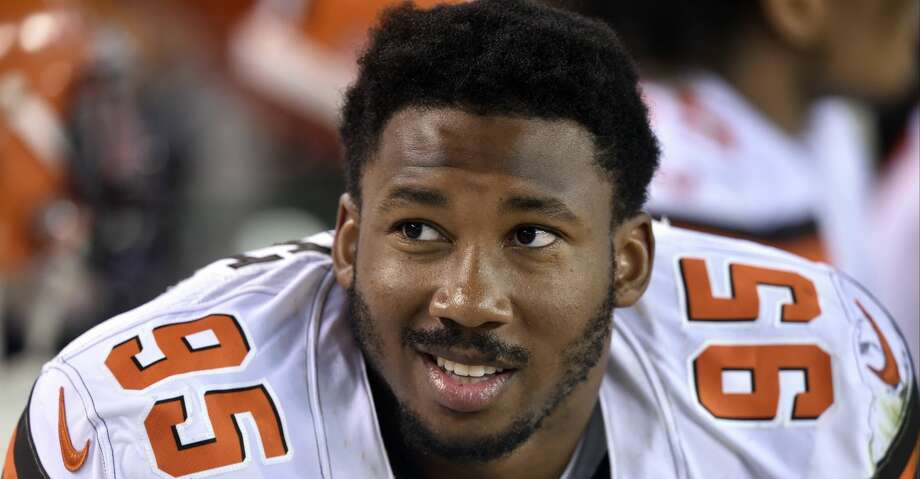 FILE - In this Aug. 10, 2017, file photo, Cleveland Browns defensive end Myles Garrett sits on the bench during the first half of an NFL preseason football game against the New Orleans Saints in Cleveland. Garrett, the No. 1 overall pick in this year's NFL draft, is back practicing after missing Cleveland's first three games with a sprained right ankle. Garrett has been out since Sept. 6, when he hurt his ankle when a teammate fell on it.  (AP Photo/David Richard, File) Photo: David Richard/Associated Press