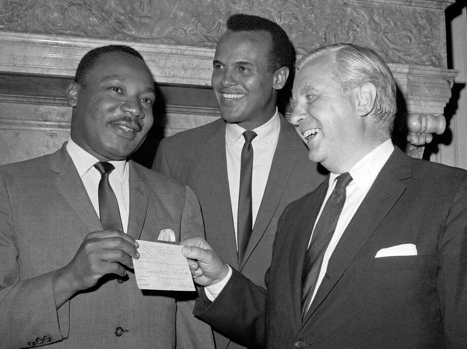 Harry Belafonte, rear, in 1966 with his friend Martin Luther King Jr. and Tore Tallroth, consul-general for Sweden in New York City, presenting King with a check for the civil rights movement. Photo: Jacob Harris / AP File Photo / AP1966