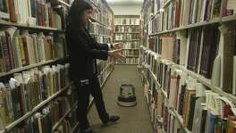 Agnieszka Czeblakow, a librarian for rare books at the University of Texas at San Antonio, looks for a cookbook in the school's vault that has more than 1,800 titles in its cookbook collection. One of the books in the collection dates back to 1789.