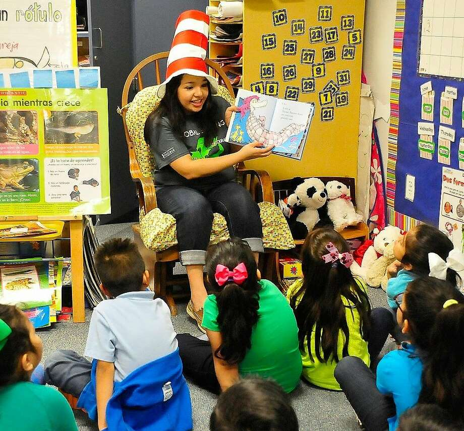 Following an energetic reading of a Dr. Seuss book, college student Kimberly Lopez plays a game with Golden Acres Elementary School children in Pasadena, Texas. Lopez visited the school with her San Jacinto College peers in celebration of Read Across America and Dr. Seuss Week.