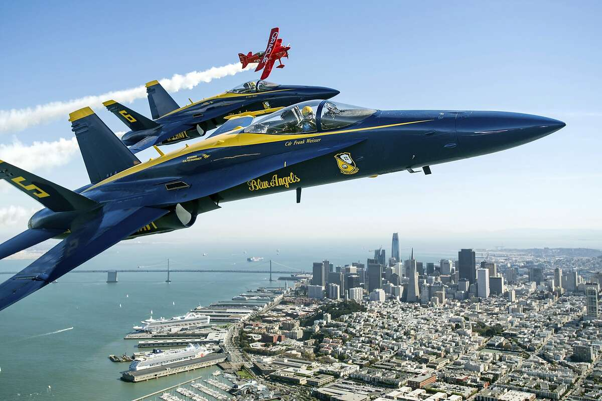 In advance of Fleet Week performances, the U.S. Navy Blue Angels and Team Oracle aerobatics pilot Sean D. Tucker fly over the San Francisco Bay during a photo flight on Thursday, Oct. 5, 2017. (AP Photo/Noah Berger)