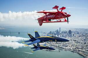 In advance of Fleet Week performances, Team Oracle aerobatics pilot Sean D. Tucker and U.S. Navy Blue Angels fly over the San Francisco Bay during a photo flight on Thursday, Oct. 5, 2017. (AP Photo/Noah Berger)
