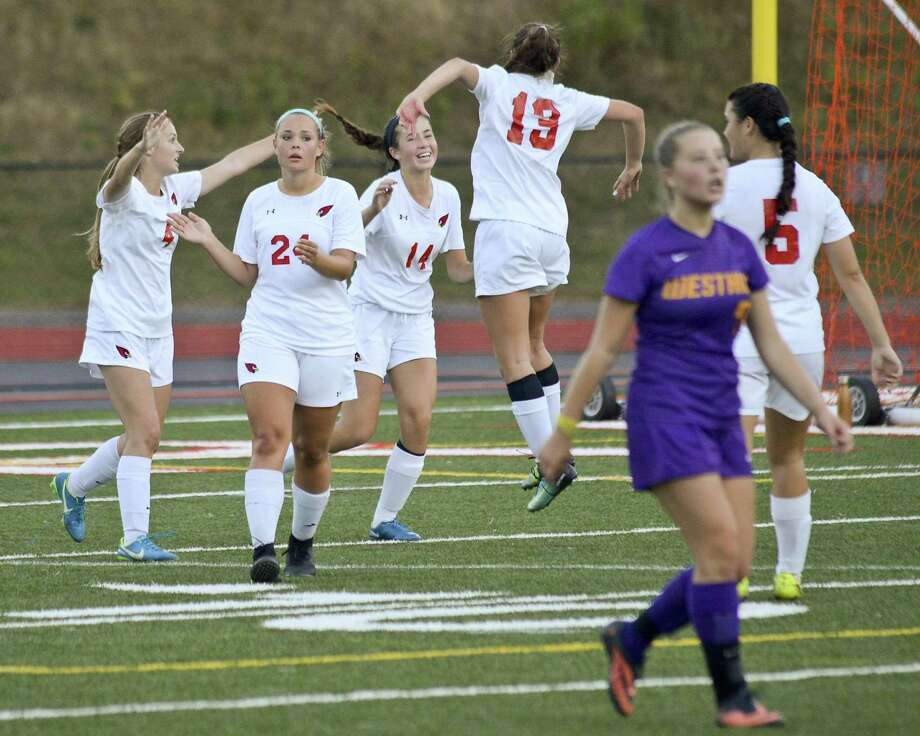 Greenwich Sofia Zajec (14) and Willow Wolfe (19) celebrate the Lady Cardinals 4-3 win over Westhill in an FCIAC girls soccer game at Cardinal Stadium  in Greenwich, Connecticut on Friday, Oct. 6,  2017. Photo: Matthew Brown / Hearst Connecticut Media / Stamford Advocate