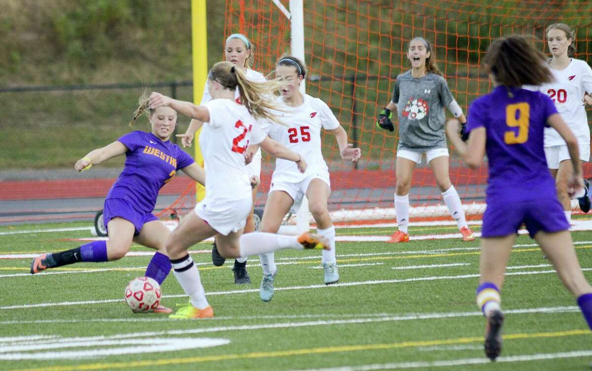 Westhill Malina Lasicki (7) attempts to push the ball into the crease on Greenwich Katherine Gallagher (22) in an FCIAC girls soccer game at Cardinal Stadium in Greenwich, Connecticut on Friday, Oct. 6, 2017. Greenwich defeated Westhill 4-3.
