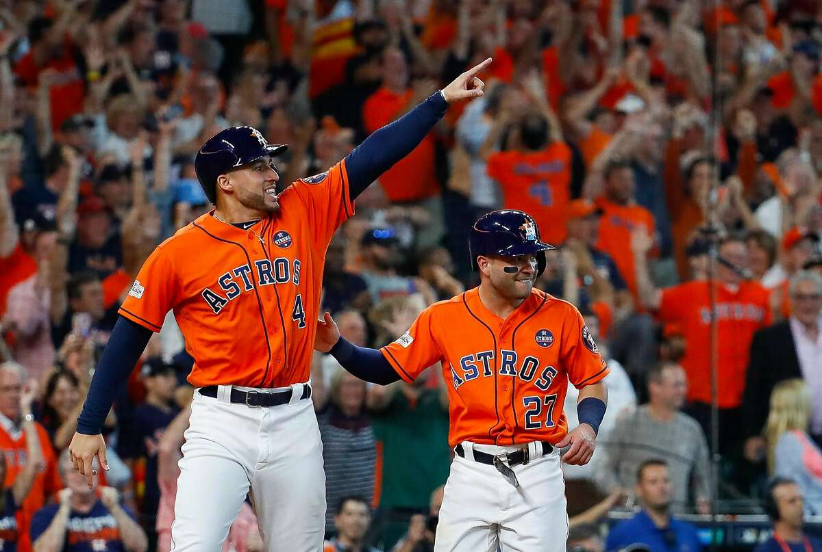 Houston Astros center fielder George Springer (4) points towards Carlos Correa at second base who had just drove in Springer and Altuve on a two-run double in the sixth inning of Game 2 of the ALDS at Minute Maid Park on Friday, Oct. 6, 2017, in Houston. ( Karen Warren / Houston Chronicle )