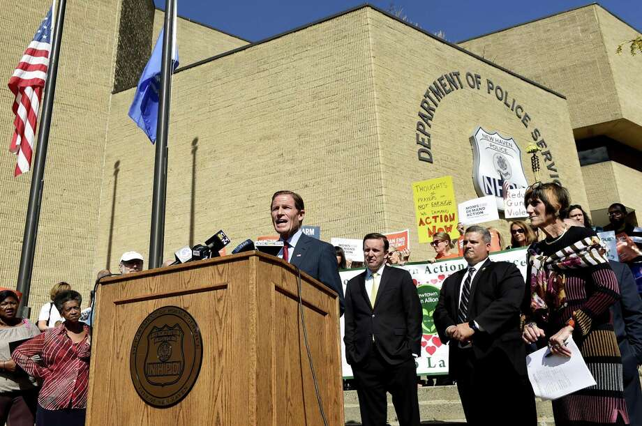 U.S. Sen. Richard Blumenthal, at lectern, Sen.  Chris Murphy,  third from right, and U.S. Rep.  Rosa L. DeLaurofar right, are seen with others  during a press conference Friday in front of the New Haven Police Department. Standing second from right is New Haven police Lt. Herbert Johnson. Photo: Peter Hvizdak / Hearst Connecticut Media / New Haven Register
