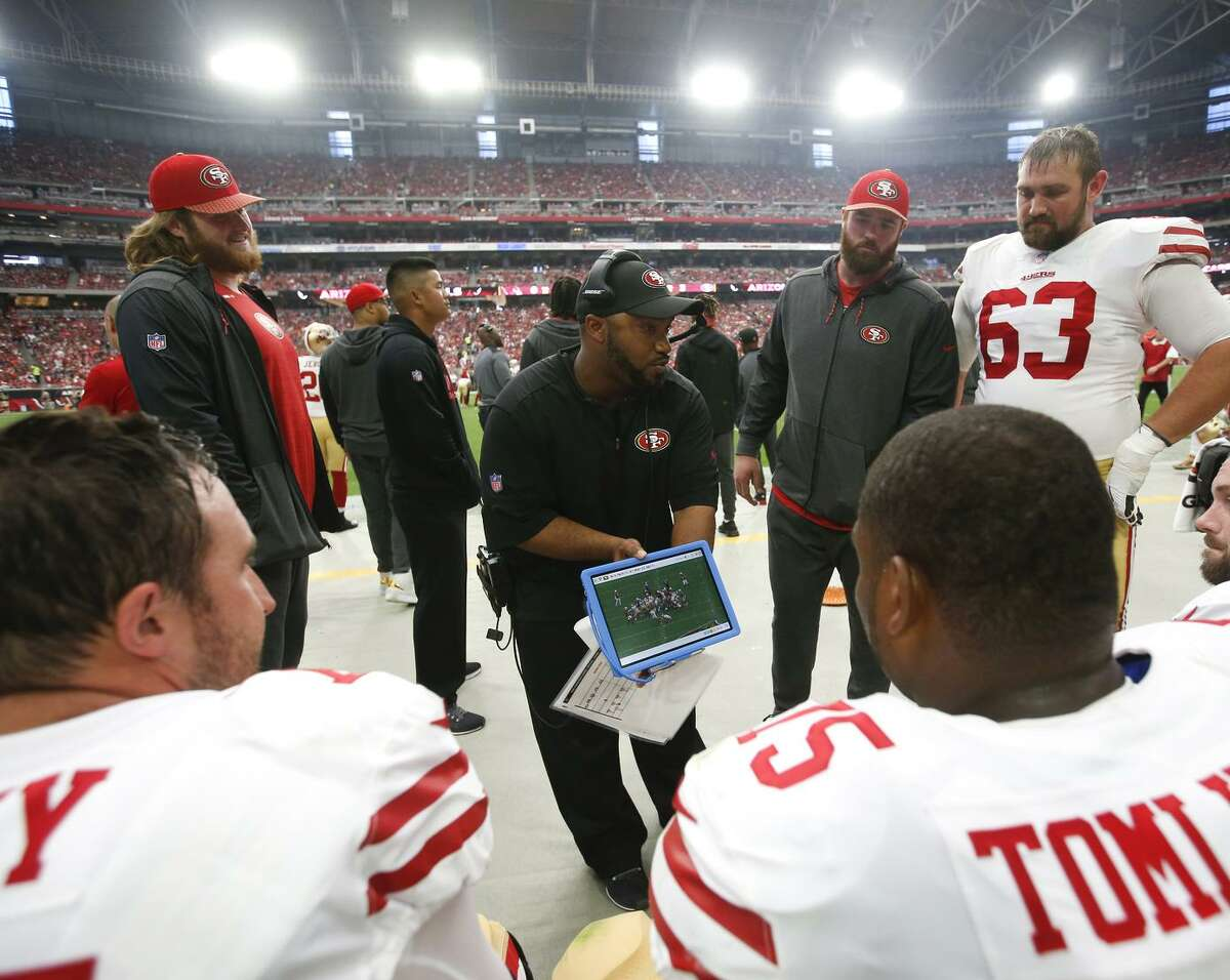 Richard Hightower (center) is in his first season as a special-teams coordinator, although he prepped for the job as a special-teams assistant with the Bears and 49ers.