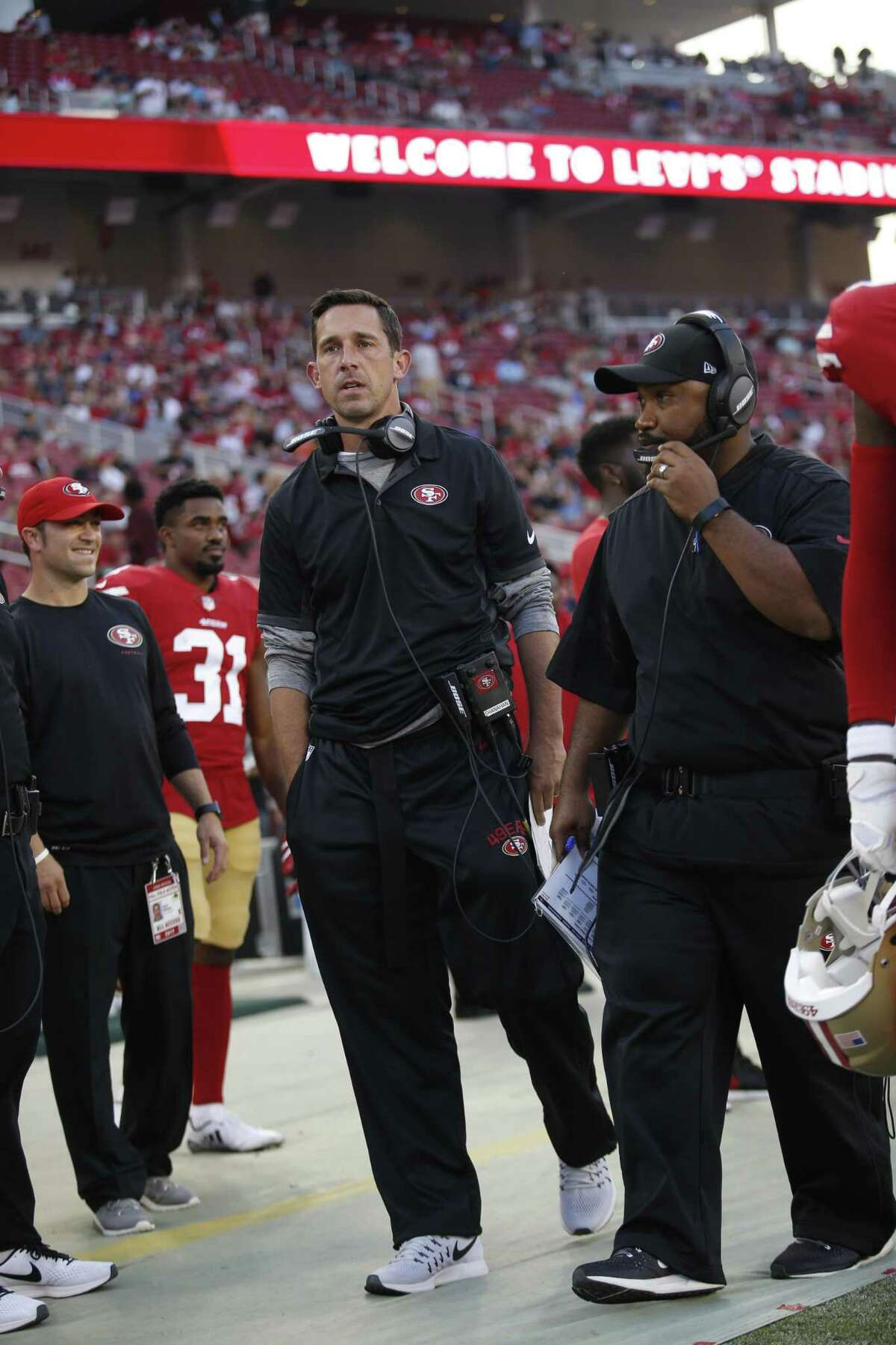 SANTA CLARA, CA - AUGUST 31: Head Coach Kyle Shanahan and Special Teams Coordinator Richard Hightower of the San Francisco 49ers stands on the sideline prior to the game against the Los Angeles Chargers at Levi's Stadium on August 31, 2017 in Santa Clara, California. The 49ers defeated the Chargers 23-13. (Photo by Michael Zagaris/San Francisco 49ers/Getty Images)