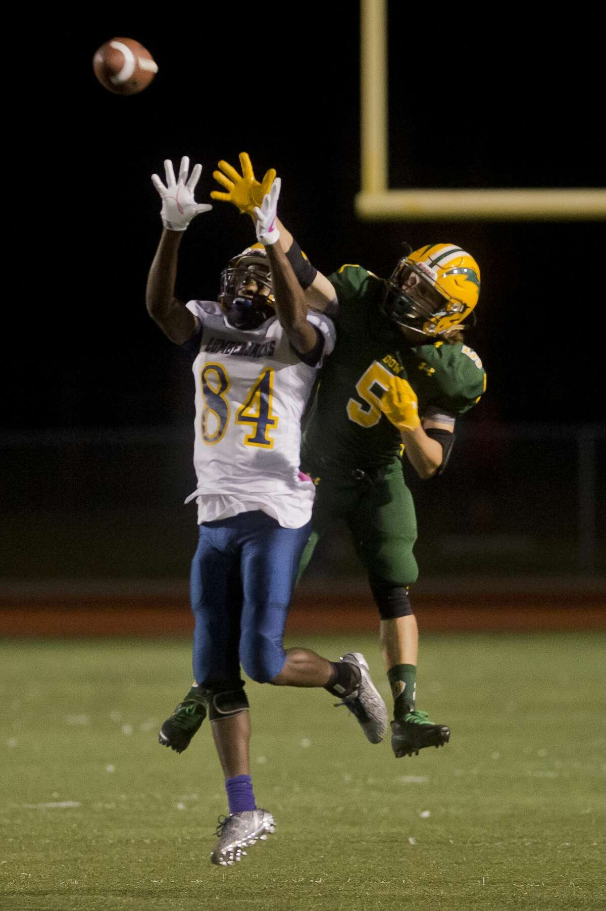 Dow junior Chase Perry attempts to block a pass thrown to Arthur Hill senior Andre Jackson during a game on Friday, Oct. 6, 2017 at Midland Community Stadium. (Katy Kildee/kkildee@mdn.net)