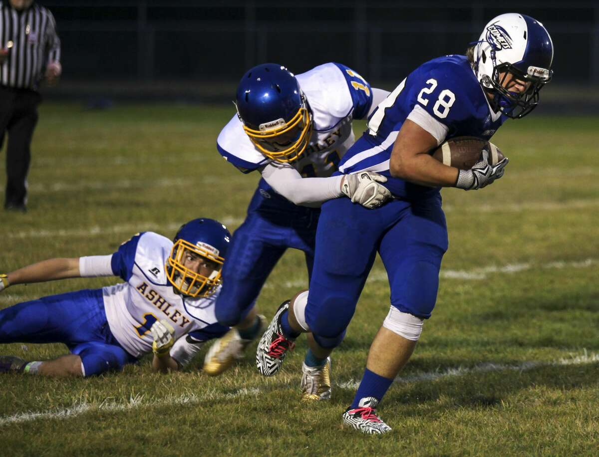 Coleman's Cooper Cozat carries the ball as Ashley's Justin Efu tries to tackle him during Coleman High School's homecoming football game against Ashley High School Friday, Oct. 6, 2017. (Josie Norris/for the Daily News)