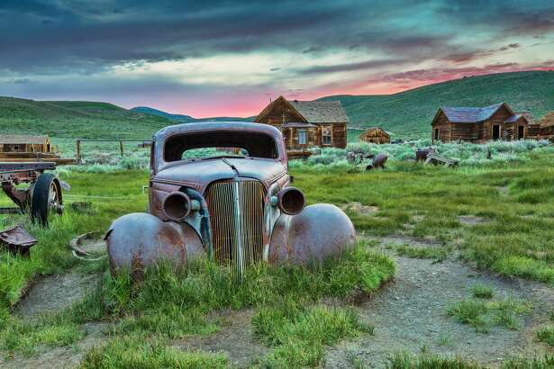 This is a photo of an old truck in Bodie State Historic Park taken at sunset. Bodie is a well preserved ghost town in California.