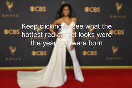 Keep clicking to see what the hottest red carpet looks were the year you were born.