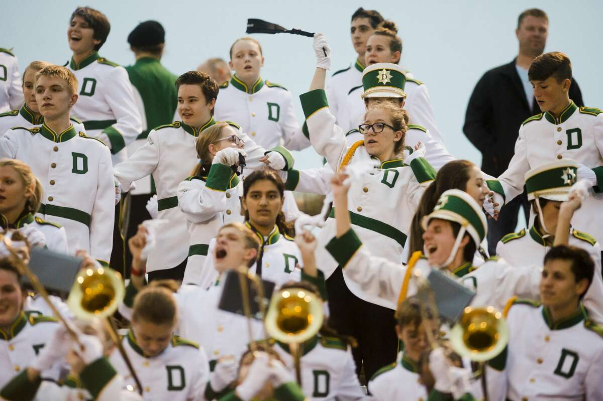 Members of the Dow High Marching Band cheer during Dow's homecoming game against Arthur Hill on Friday, Oct. 6, 2017 at Midland Community Stadium. (Katy Kildee/kkildee@mdn.net)