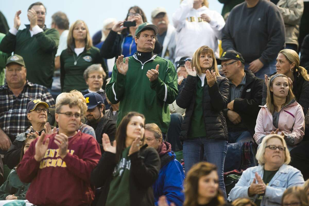 Fans watch during Dow's homecoming game against Arthur Hill on Friday, Oct. 6, 2017 at Midland Community Stadium. (Katy Kildee/kkildee@mdn.net)