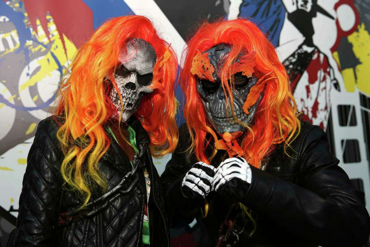 Attendees dressed in costume pose for a photo during New York Comic Con, Friday, Oct. 6, 2017. The event runs through Oct. 8 at the Javits Center, Madison Square Garden, and the Hammerstein Ballroom. (AP Photo/Steve Luciano)