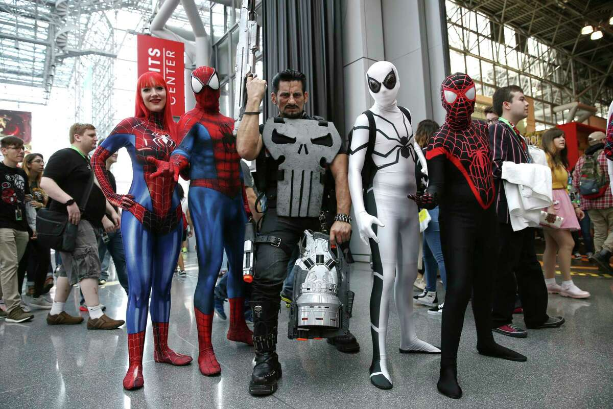 Fans dressed in costume pose for a photo during New York Comic Con, Friday, Oct. 6, 2017. The event runs through Oct. 8 at the Javits Center, Madison Square Garden, and the Hammerstein Ballroom. (AP Photo/Steve Luciano)