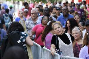 Thousands wait in line to apply for emergency food aid. The Disaster Supplemental Nutrition Assistance Program benefits are pegged on the size of the household requesting assistance.