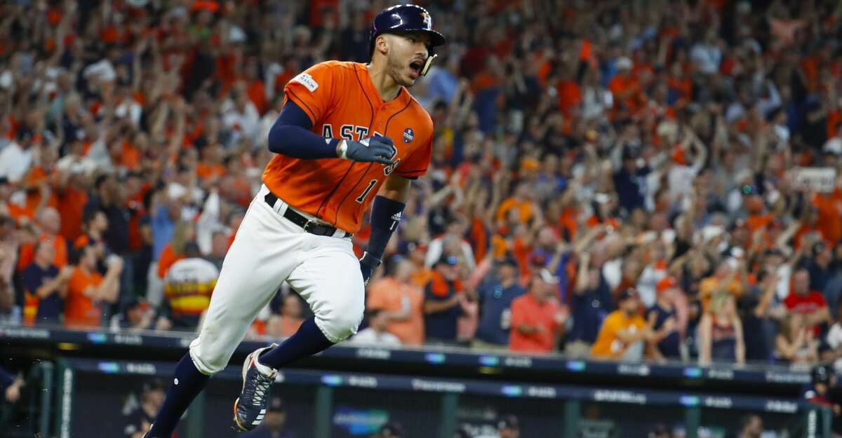 Houston Astros shortstop Carlos Correa (1) runs towards first after hitting a two-run double during the sixth inning of Game 2 of the ALDS at Minute Maid Park on Friday, Oct. 6, 2017, in Houston. ( Karen Warren / Houston Chronicle )