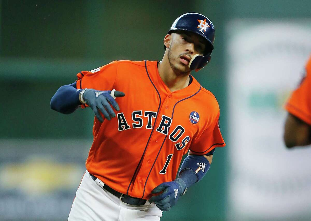 HOUSTON, TX - OCTOBER 06: Carlos Correa #1 of the Houston Astros runs the bases after hitting a two-run home run in the first inning against the Boston Red Sox during game two of the American League Division Series at Minute Maid Park on October 6, 2017 in Houston, Texas. (Photo by Bob Levey/Getty Images) ORG XMIT: 775053706