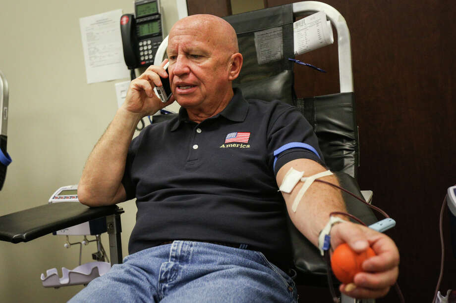 U.S. Rep. Kevin Brady, R-The Woodlands, gives blood during the Gulf Coast Regional Blood Center's blood drive for victims of Las Vegas on Friday, Oct. 6, 2017, at the Conroe VA Outpatient Clinic. Photo: Michael Minasi, Staff Photographer / © 2017 Houston Chronicle
