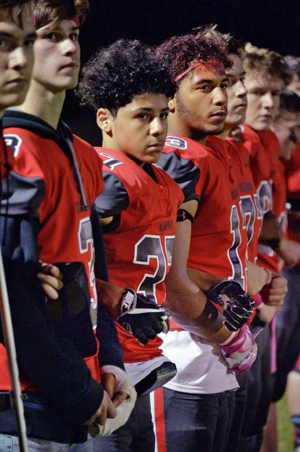 Niskayuna football players lock arms as they all stand for the national anthem is played before their game with Schenectady High Friday Oct. 6, 2017 in Niskayuna, NY.  (John Carl D'Annibale / Times Union) Photo: John Carl D'Annibale, Albany Times Union / 20041775A