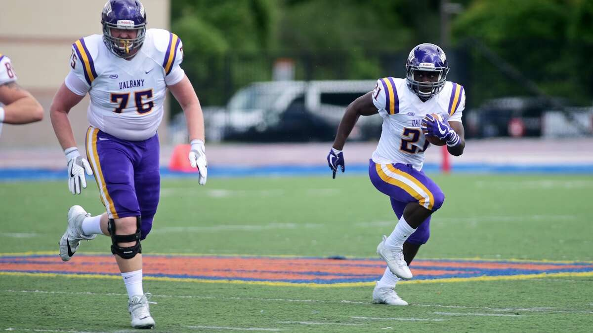 UAlbany running back Karl Mofor runs downfield behind a lead block from offensive lineman Luke Ritter against Morgan State in their game at Hughes Stadium in Baltimore on Saturday, Sept. 9, 2017. (Mark Coleman / UAlbany Athletics)