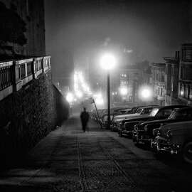 Man walks down Mason Street on Nob Hill between Pine and California streets, near the Mark Hopkins hotel, in the late 1950s.