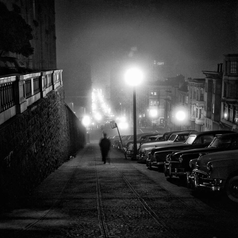 A late 1950s photo by Fred Lyon shows a man walking down Mason Street on Nob Hill between California and Pine streets next to the Mark Hopkins Hotel. Photo: Fred Lyon, Handout Photo