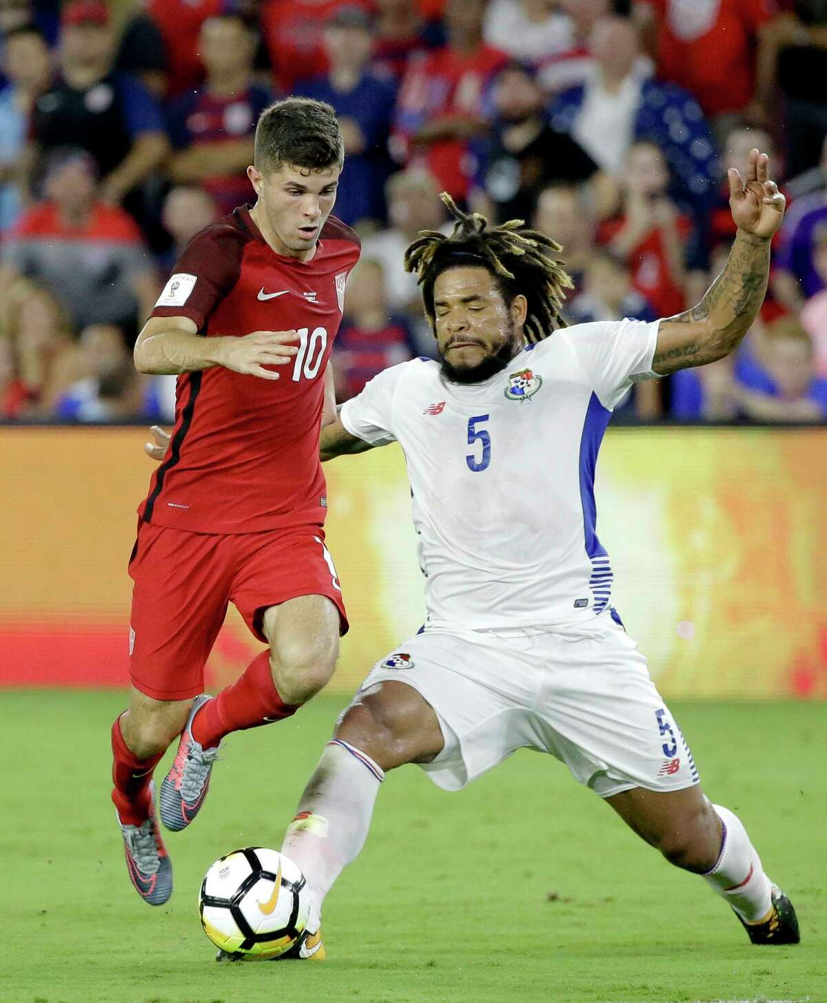 United States' Christian Pulisic (10) tries to get past Panama's Roman Torres (5) during the first half of a World Cup qualifying soccer match, Friday, Oct. 6, 2017, in Orlando, Fla. (AP Photo/John Raoux) ORG XMIT: FLJR107