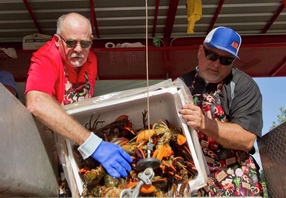 Lone Star Catering cooks Steve Sondag, left, and Scott Kenee before the Conroe/Lake Conroe Area Chamber of Commerce's annual Lobsterfest at Lone Star Convention & Expo Center Thursday in Conroe. Photo: Jason Fochtman, Staff Photographer / © 2017 Houston Chronicle