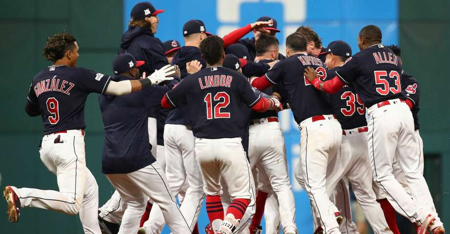 CLEVELAND, OH - OCTOBER 06:  Yan Gomes #7 of the Cleveland Indians celebrates with teammates after he hit a an RBI single scoring Austin Jackson #26 to win the game 9 to 8 in the 13th inning during game two of the American League Division Series at Progressive Field on October 6, 2017 in Cleveland, Ohio.  (Photo by Gregory Shamus/Getty Images) Photo: Gregory Shamus/Getty Images