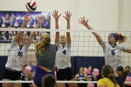 La Vernia's Brianna Woitaske (10), Meghan Stiefer (4) and Chloe Patton (6) defend against Navarro's Peyton Roach (7) in girls volleyball in La Vernia on Friday, Oct. 6, 2017. La Vernia won the deciding fifth game for the overall victory.