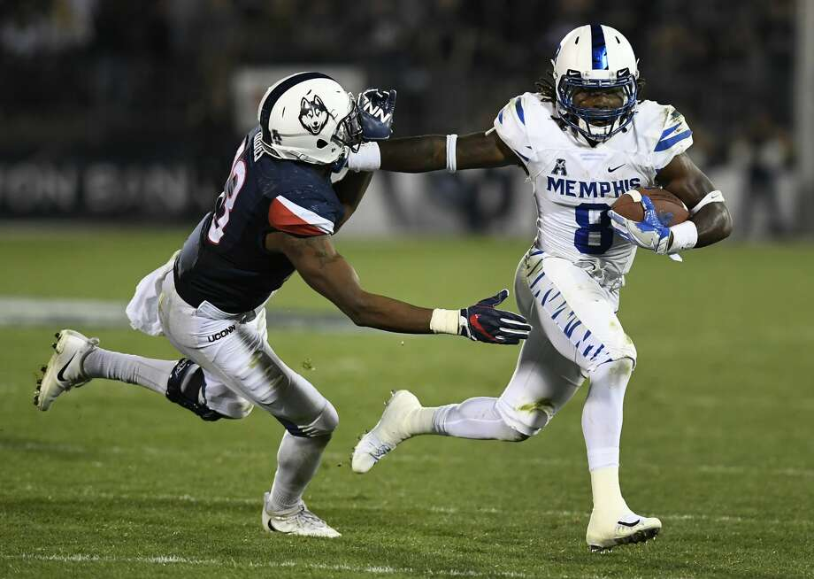 Memphis running back Darrell Henderson (8) fends off Connecticut linebacker Vontae Diggs (13) during the second half of an NCAA college football game, Friday, Oct. 6, 2017, in East Hartford, Conn. (AP Photo/Jessica Hill) Photo: Jessica Hill/AP