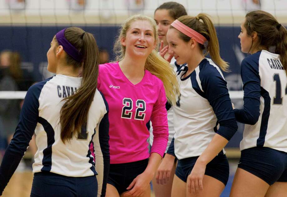 College Park\'92s CC Clausen (1) smiles as she looks up at the scoreboard after the Lady Cavaliers defeated Conroe in straight sets during a District 12-6A high school volleyball match at College Park High School, Tuesday, Oct. 3, 2017. Photo: Jason Fochtman, Staff Photographer / © 2017 Houston Chronicle