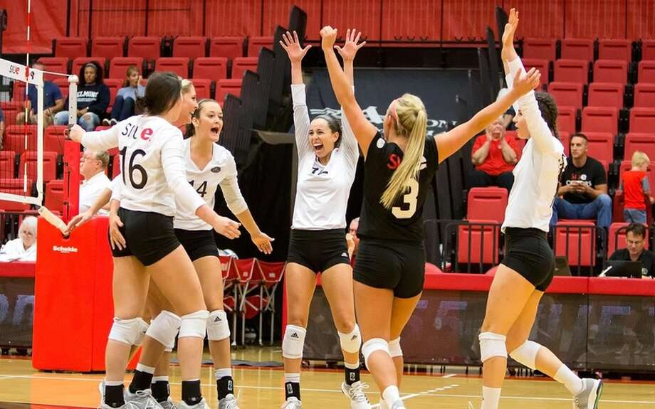 SIUE celebrates winning a point.