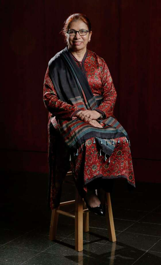 Dr. Saleha Khumawala sits for her stool portrait in Melcher Hall at the University of Houston in Houston, TX, Sept. 28, 2017. (Michael Wyke / For the  Chronicle) Photo: Michael Wyke, Freelance / © 2017 Houston Chronicle