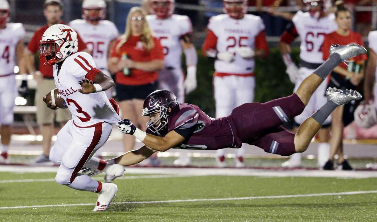 Tomball quarterback Tybo Taylor is caught by Magnolia's Stevie Towchik in the first half of their game at Bulldog Stadium in Magnolia, TX, Oct. 5, 2017. (Michael Wyke / For the Chronicle)