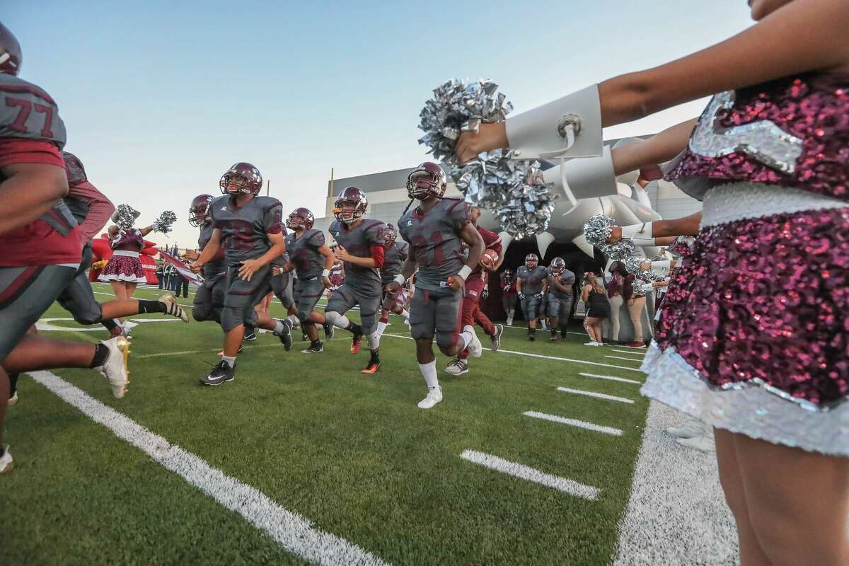Bellaire's football team enters the field before taking on Heights at Delmar Stadium Friday, Oct. 6, 2017, in Houston. ( Steve Gonzales / Houston Chronicle )