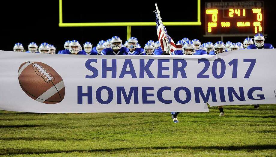 Shaker players take the field against Troy during a Section II Class AA high school football game in Latham, N.Y., Friday, Oct. 6, 2017. (Hans Pennink / Special to the Times Union) ORG XMIT: HP101 Photo: Hans Pennink / Hans Pennink