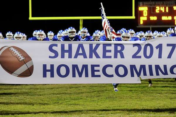 Shaker players take the field against Troy during a Section II Class AA high school football game in Latham, N.Y., Friday, Oct. 6, 2017. (Hans Pennink / Special to the Times Union) ORG XMIT: HP101